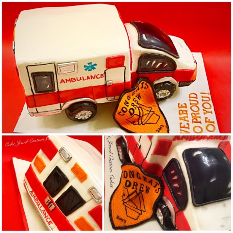 Red and white ambulance sculpted cake