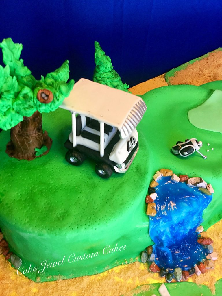 Golf course cake with fondant cart and golf bag
