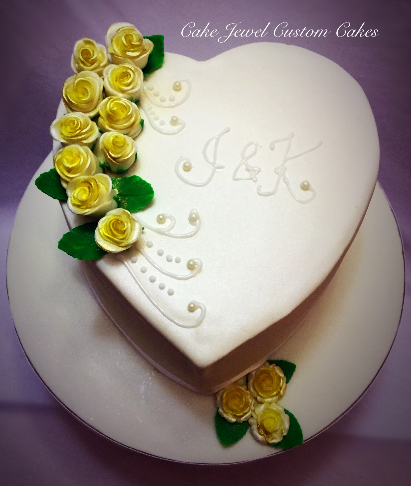 Ivory and yellow rose heart shaped cake